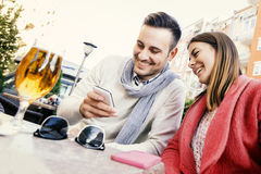Couple drinking beer in a bar Royalty Free Stock Photo
