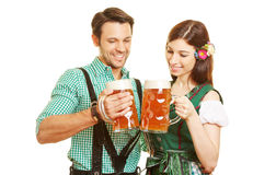Couple drinking beer in Bavaria Stock Image