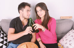 Couple drinking beer and eating pizza. Stock Images