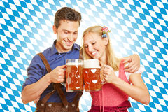 Couple drinking beer at Oktoberfest Royalty Free Stock Image