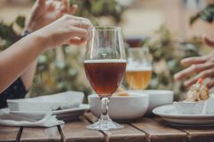 A Couple Drinking. Beer Outside Stock Image