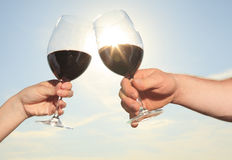 A couple drinking a bottle of red wine outside Stock Photo