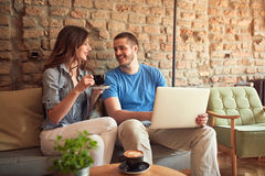 Couple drinking cappuccino in cafe Stock Photo