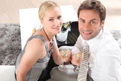 Couple drinking champagne Stock Photos