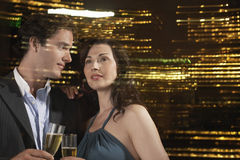 Couple Drinking Champagne Against Night Skyline Royalty Free Stock Photos