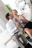 Couple drinking champagne for birthday Stock Images