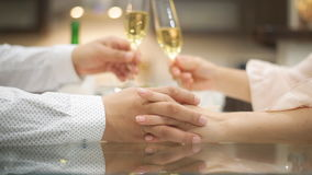 Couple drinking champagne and holding hands. stock video