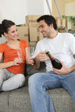 Couple drinking champagne at home Stock Photography