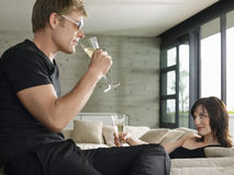 Couple Drinking Champagne In Living Room Royalty Free Stock Photo