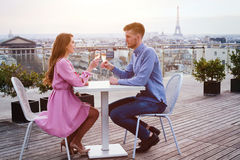 Couple drinking champagne in luxury restaurant. Couple drinking champagne in luxury rooftop restaurant in Paris with panoramic view of Eiffel Tower Royalty Free Stock Photo