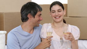 Couple drinking champagne in new house. Footage in high definition stock video footage