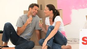 Couple drinking champagne together. After painting stock video footage