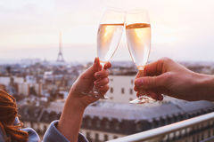Couple drinking champagne or wine. Two glasses of champagne or wine, couple in Paris, romantic celebration of engagement or anniversary royalty free stock images