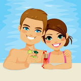 Couple Drinking Cocktail On Pool Royalty Free Stock Image