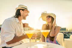 Couple drinking cocktails at bar Royalty Free Stock Photography