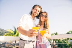 Couple drinking cocktails at bar Royalty Free Stock Image