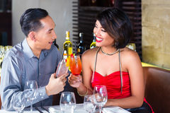 Couple drinking cocktails in fancy bar Stock Images