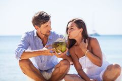Couple drinking coconut cocktail royalty free stock photos