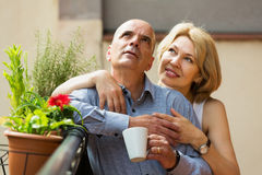 Couple drinking coffee at balcony Royalty Free Stock Photography