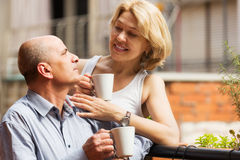 Couple drinking coffee at balcony Royalty Free Stock Image