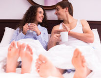 Couple drinking coffee in the bed Royalty Free Stock Photography