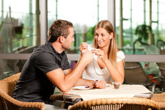 Couple drinking coffee in cafe Royalty Free Stock Images
