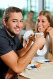 Couple drinking coffee in cafe Royalty Free Stock Photography
