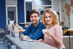 Couple drinking coffee in the cafe Royalty Free Stock Image