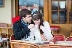 Couple drinking coffee in a cafe Royalty Free Stock Image