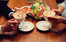 Couple drinking coffee in a cafe. Couple drinking coffee at cafe restaurant man and woman with cup of espresso hot cappuccino on dating. Concept of male and royalty free stock photo