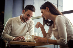 Couple drinking coffee and chatting in cafe Royalty Free Stock Images
