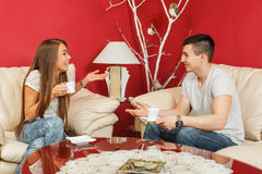 Couple drinking coffee and chatting Royalty Free Stock Photography