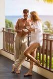Couple drinking coffee and enjoying sun Royalty Free Stock Photos