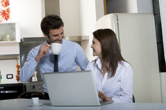 Couple drinking coffee before going to work Royalty Free Stock Image