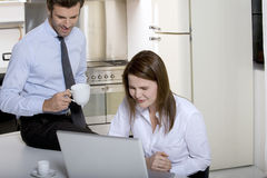 Couple drinking coffee before going to work Stock Image