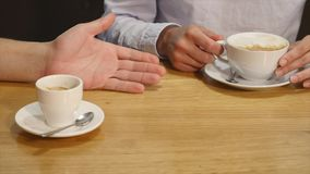 Couple drinking coffee laughing in cafe stock video