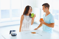 Couple drinking coffee and laughing Stock Images