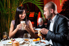 Couple drinking coffee at restaurant Stock Images