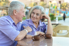 Couple drinking coffee. Senior couple drinking coffee outside at the resort during vacation Royalty Free Stock Photo