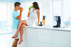 Couple drinking coffee and spending time together in the kitchen Royalty Free Stock Images