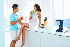 Couple drinking coffee and spending time together in the kitchen Stock Images