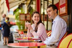 Couple drinking coffee or tea in a Parisian cafe Royalty Free Stock Photo