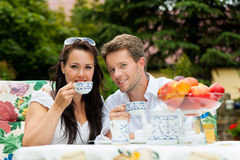 Couple drinking coffee in their garden Stock Photos