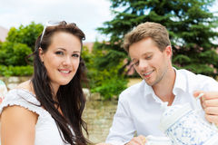 Couple drinking coffee in their garden Stock Images