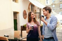 Couple Drinking Coffee And Walking At Street. Royalty Free Stock Photos