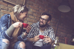 Couple drinking coffee Stock Images