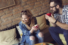 Couple drinking coffee Stock Photos