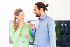 Couple drinking cup of coffee in kitchen Stock Photo