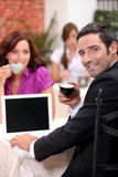 Couple drinking expresso in a cafe Stock Images