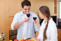 Couple drinking a glass of red wine Royalty Free Stock Images